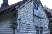 stock photo of abandoned house  - An abandoned wooden house needs some work - JPG