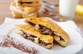 stock photo of french toast  - French toast stuffed with chocolate and banana fresh milk clean composition - JPG