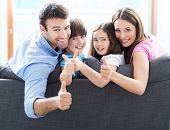 picture of thumb  - Family at home with thumbs up  - JPG