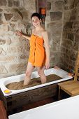 pic of loam  - Woman in bath with clay  - JPG