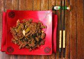 stock photo of stir fry  - Vietnamese beef stir fry served on a wood table top - JPG