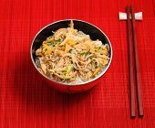 image of rice noodles  - Vietnamese vermicelli chicken and rice noodles soup pho served on a bamboo place mat - JPG