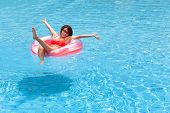 foto of swimming  - happy Young woman relaxing in swimming pool - JPG