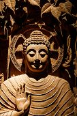 foto of carving  - Buddha carved wood at temple in Thailand - JPG