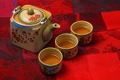 pic of ceremonial clothing  - Asian tea set served on a silk table cloth - JPG