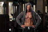 picture of hoodie  - Portrait Of A Physically Fit Man In Hoodie  - JPG