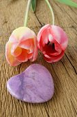 picture of two hearts  - Two Tulips and a purple stone heart on a rustic wooden plank - JPG
