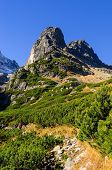stock photo of mountain-climber  - Characteristically pointed mountain peak very popular among climbers in Tatra mountains - JPG