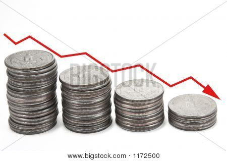 Picture or Photo of Red down arrow over stacks of coins isolated against a white background