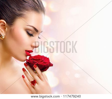 Beauty Woman with red rose. Fashion Model Girl face Portrait with Red Rose in her hand. Red Lips and