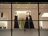 Elegant Mannequins In Black Evening Gowns In A Department Store Window