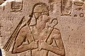 stock photo of sceptre  - Ancient Egyptian hieroglyphic carving of a Pharaoh holding a flail - JPG