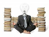 Businessman In Lotus Pose And Lamp-head With Many Books Near