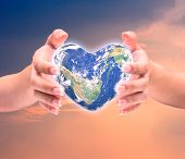 World In Heart Shape With Over Women Human Hands On Blurred Natural Background Blue Cyan Turquoise T poster