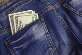 Постер, плакат: Dollars In Jeans Pocket