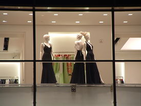 image of department store  - elegant mannequins in black evening gowns in a department store window - JPG