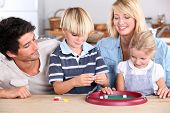 Family playing game at kitchen table