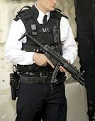 foto of mp5  - Armed british police officer on duty with a mp5 - JPG