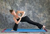 Woman Doing Yoga Posture Parivrtta Parsvakonasana Or Revolved Extended Side Angle Pose Variation