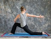 Woman Doing Yoga Posture Rotated Low Lunge Or Ashwa Sanchalanasana