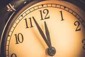 Old Grunge Vintage Alarm Clock Is Showing Midday Or Midnight Movement. It Is Twelve Oclock, Holiday poster