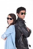 Young couple being cool in sunglasses and leather jacket