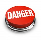 A red button with the word Danger, illustrating the hazards and need for caution in a situation.  Pr