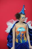 MOSCOW - OCTOBER 2: Beautiful model with bodyart and hat as Eiffel Tower at XVII International Festival