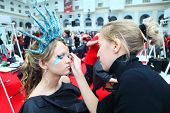 MOSCOW - OCTOBER 2: Young visagiste makes body art at XVII International Festival