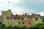 foto of hever  - Hever castle side view with flag flying and storm sky - JPG