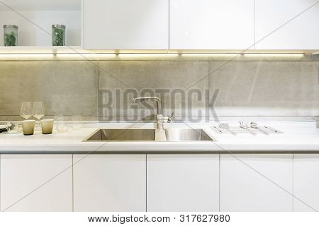 poster of Stainless Kitchen Sink And Tap Water In The Kitchen. The Interior Of The Kitchen Room Of The Apartme