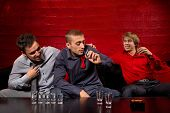 pic of shot glasses  - Men drinking shots in night club - JPG