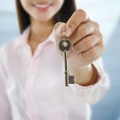 Property Agent holding a key