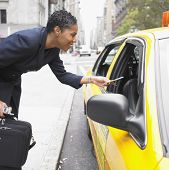 Businesswoman paying cab fare