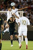LOS ANGELES - JULY 16: Real Madrid D Raphael Varane #19 Xabi Alonso #14 & Los Angeles Galaxy F Adam