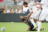 LOS ANGELES - JULY 16: Los Angeles Galaxy M Juninho #19 gets taken down by Real Madrid C.F. M Sami Khedira #24 during the World Football Challenge game on July 16 2011 at Los Angeles Memorial Coliseum