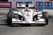 LONG BEACH - APRIL 17: Paul Tracy driver of the #8 Dragon Racing Ralphs Dallara Honda races during t