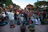 BALI, INDONESIA - MARCH 22: People on square ready to start Hindu Ngrupuk parade on March 22, 2012 i