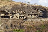 stock photo of ellora  - Buddhist cave temples carved out of the solid rock of the hillside at Ellora Caves in India - JPG