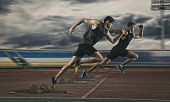 Two man sprinter leaving starting blocks on the athletic track  poster