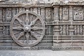 stock photo of surya  - Ornately carved stone wheel on the ancient Surya Hindu Temple at Konark Orissa India - JPG