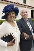 stock photo of early 60s  - Senior Couple Going to Church on Sunday - JPG