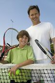 Father and Son at Tennis Net