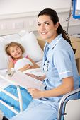 Nurse with child patient in UK Accident and Emergency