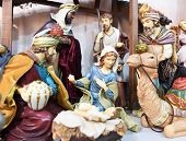 Nativity scene. Christmas. Christmas Manger scene with figurines newborn Jesus, Mary, Joseph, and ma poster