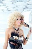 Blond 80s woman with ethnic party cancan pearly handmade dress of haute couture