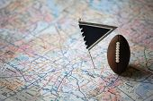 Macro Shot Of A Flag And Football Placed On Dallas, Texas In A Map. poster