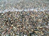 Beach Pebbles And Surf