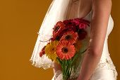 Bride's Back With Flower Bouquet