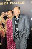 LOS ANGELES, CA - MAR 12: Woody Harrelson, Laura Louie at the premiere of Lionsgate's 'The Hunger Ga